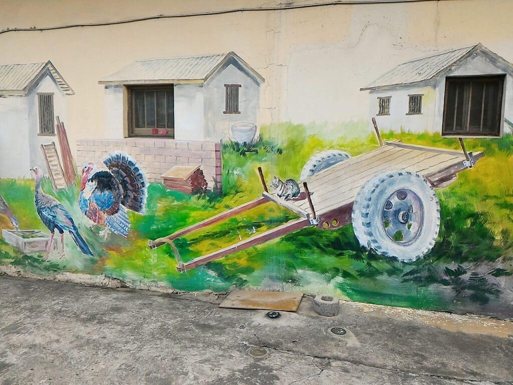 坑口彩繪村的圖片:牛車與農舍彩繪